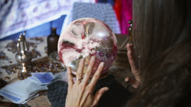 Close Up of Gypsy Looking at a Crystal Ball video