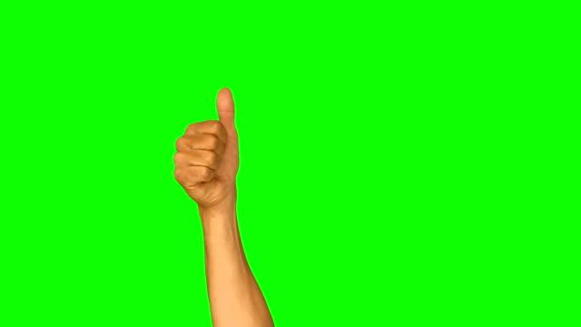 close up of hand gesturing thumbs up - thumbs up stok videoları ve detay görüntü çekimi