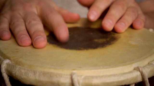 Close up of hands of a man playing a drum. Slow Motion. video