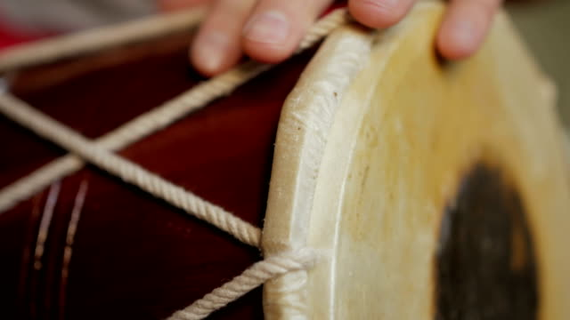 Close up of hands of a man playing a drum. video
