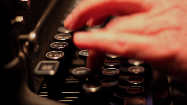 Close up of Hands Typing on a Typewriter - Profile video