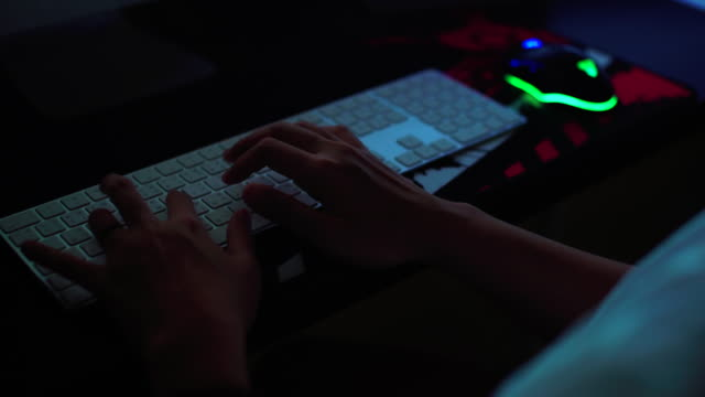 Close up of hands typing on laptop. Night work concept Close up of hands typing on laptop. Night work concept lighting technique stock videos & royalty-free footage
