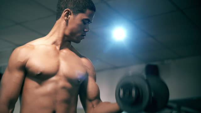 Close up of handsome man exercise with weights video