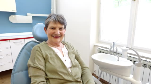 Close up of happy elderly female patient at dentist video
