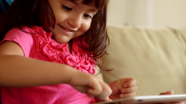 Close Up of Happy Girl Toddler Touching Tablet Screen video