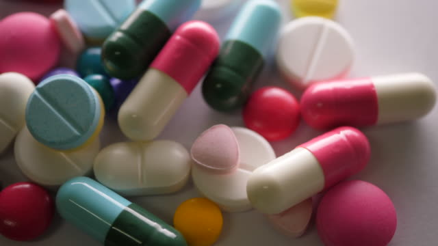 Close up of Healthy pills rotate on table Close up of Healthy pills rotate on table painkiller stock videos & royalty-free footage