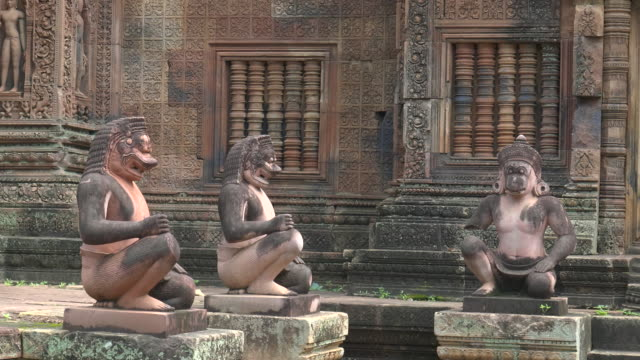 close up of hindu diety statues at banteay srei temple in angkor