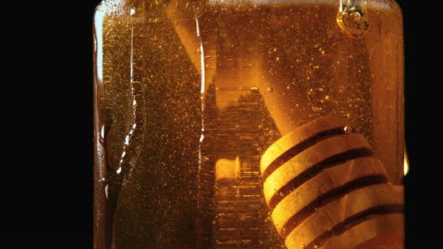 Close up of honey stick in jar video