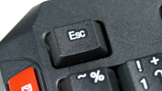 Close up of human finger pushing an Escape button on the computer keyboard video