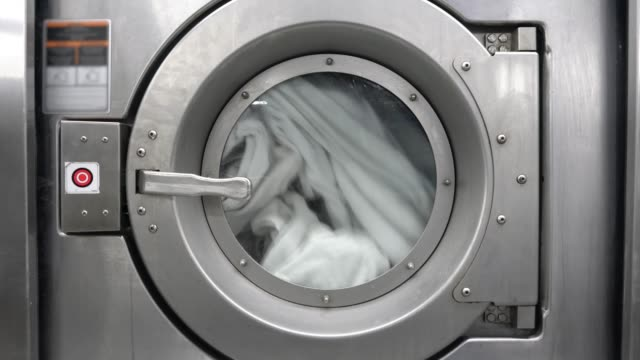 close up of industrial dryer at a laundromat - struttura pubblica video stock e b–roll