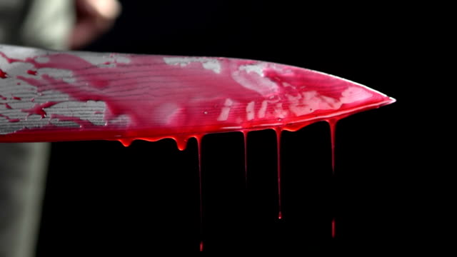 Close up of knife with blood dripping video