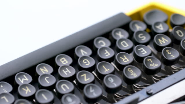 4K Close up of letter in Retro & vintage style typewriter in studio