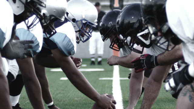 Close up of linemen  football stock videos & royalty-free footage