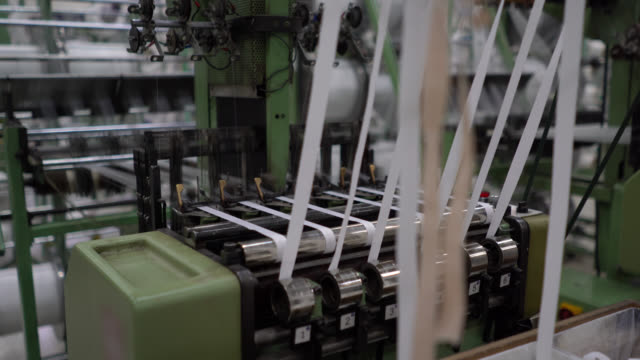 Close up of machine on motion producing rubber tapes