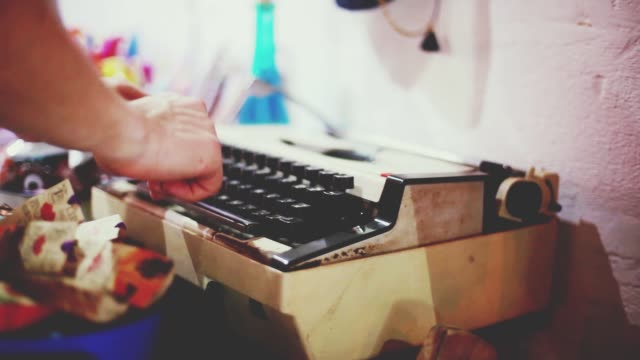 Close up of male fingers typing on the keyboard of an old-fashioned typewriter. 1920x1080 video