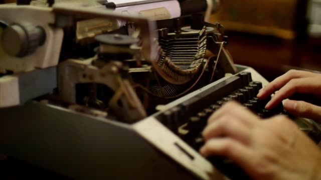 Close up of Male hands typing on the old typewriter.