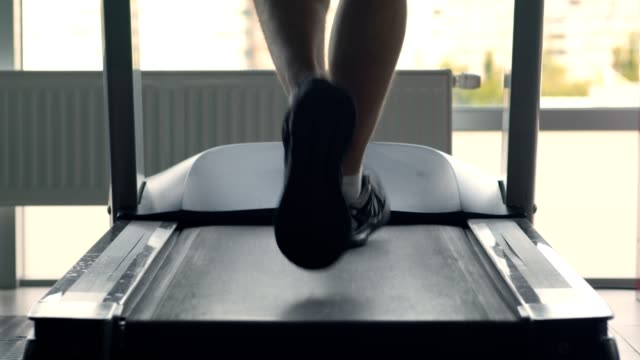close up of male legs on treadmill, man running at gym - runner rehab gym video stock e b–roll
