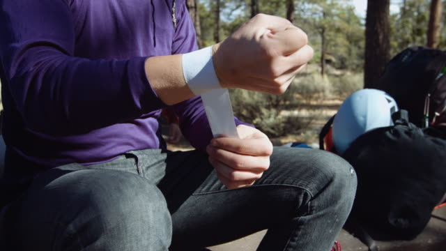 Close Up of Male Rock Climber Taping Up Hands video