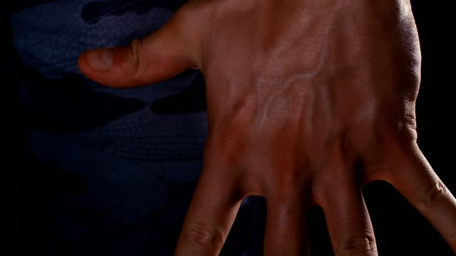 Close up of male shrinking fist, 4k