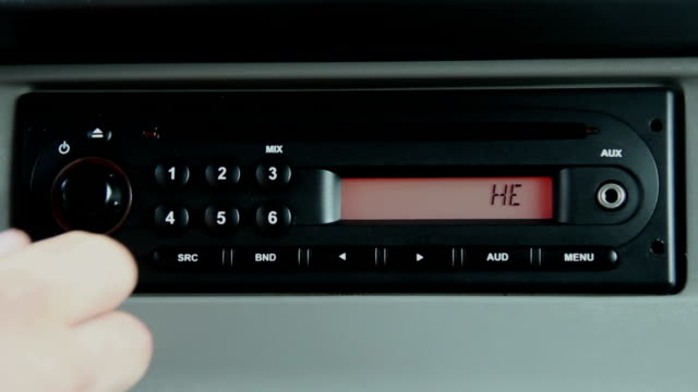 Close up of Male Turning Car Radio On video