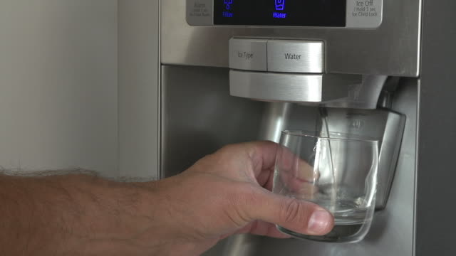 Close Up Of Man Getting Glass Of Chilled Water From Fridge video