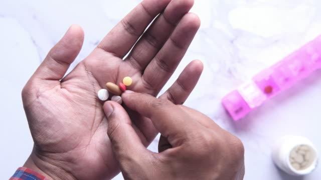 close up of man hand taking medicine - antidolorifico video stock e b–roll