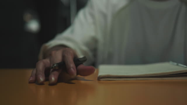 Close up of man hand while knocking on table to create the rhythm of his music for songwriter working