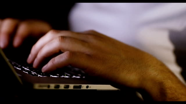 close up of man typing on keyboard - criptovaluta video stock e b–roll
