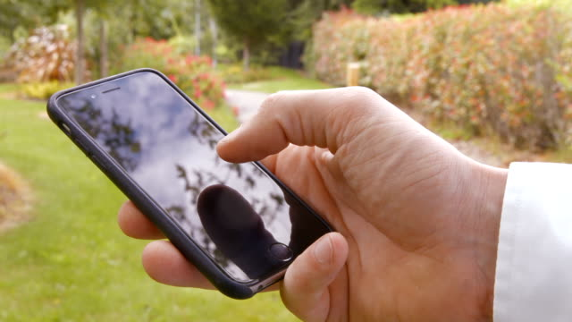 Close up of man using a smartphone