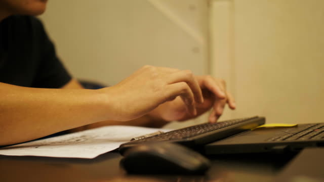 Close up of man's hand while using computer mouse with his work process video