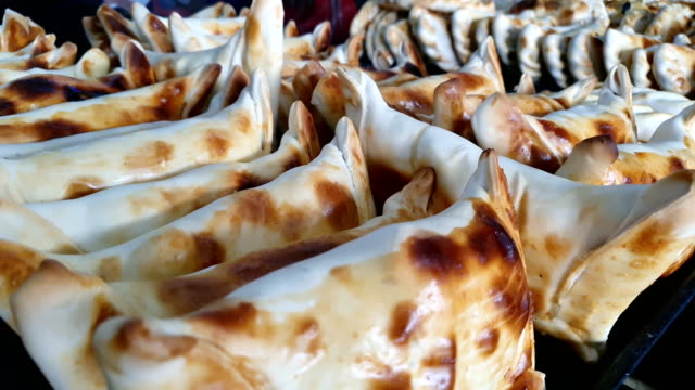 Close up of many Beef filled Empanada or Empanada de Pino, delicious Chilean baked pasty