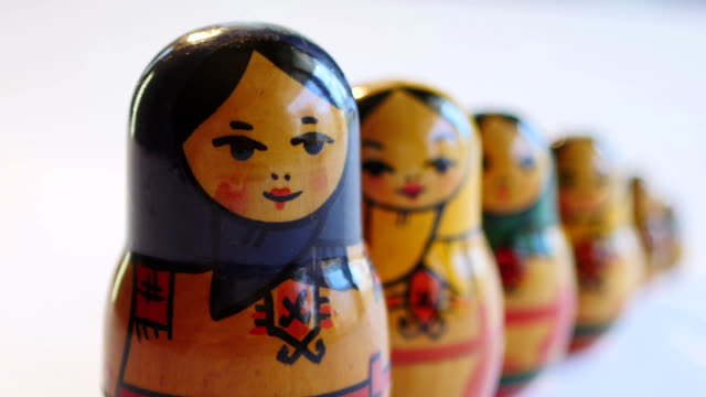 Close up of Matryoshka Doll on a white background in FullHD video