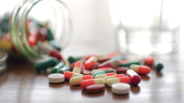 Close up of Medicine Prescription Bottles & Pills , Medical Concept , Dolly shot left to right video