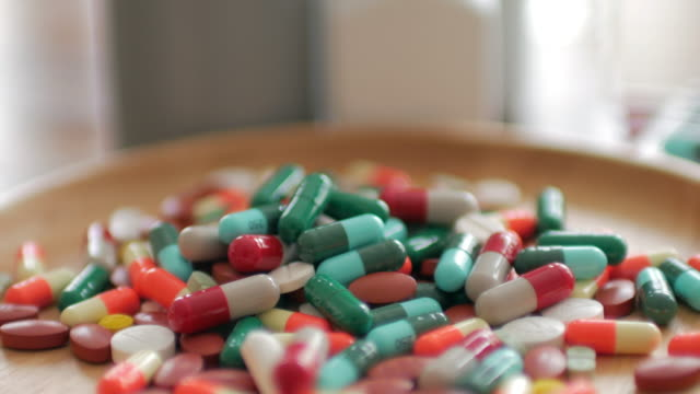 Close up of Medicine Prescription Bottles & Pills , Medical Concept , Dolly shot video