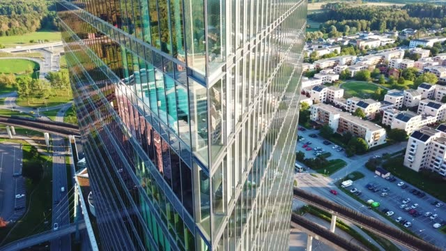 Close up of modern glass and steel building Close up of modern glass and steel building large stock videos & royalty-free footage