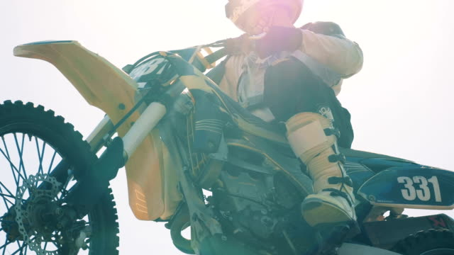 Close up of motorbike's body frame with a rider sitting on it