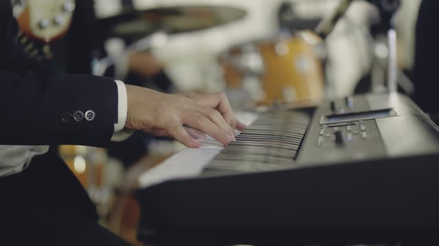 Close up of musician hand playing paino Musician playing keyboard in concert. Bangkok, Thailand. classical concert stock videos & royalty-free footage