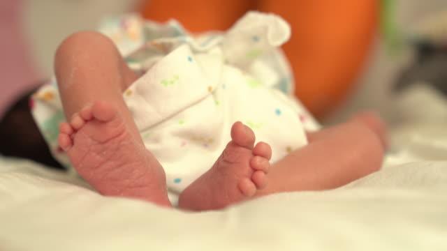 close up of newborn baby feet