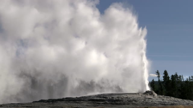 close up of old faithful erupting in yellowstone