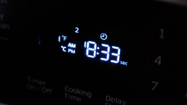 Close up of oven display flickering control panel blinking. Electricity problem.