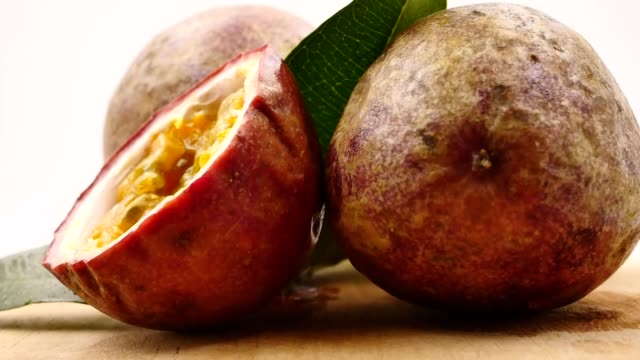 close up of passion fruit on wooden tray - passiflora video stock e b–roll