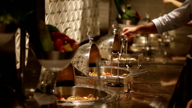close up of people hand catering buffet food at the party. - buffet video stock e b–roll