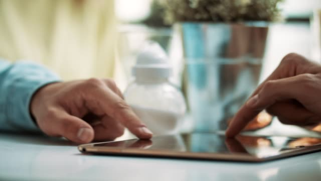 Close up of people using digital tablet touch screen video
