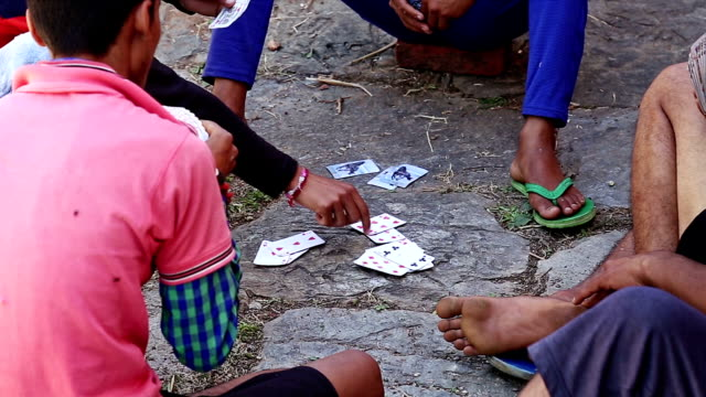 Close up of  playing card in Indian village boys playing cards video