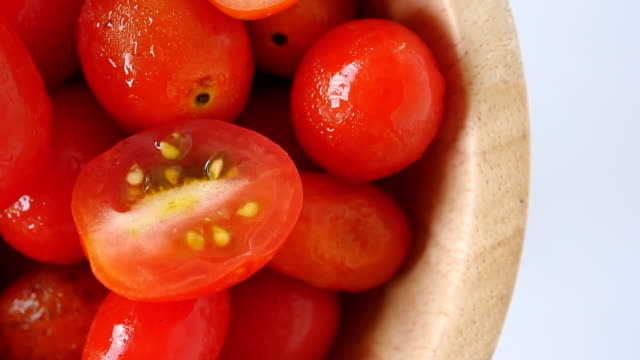 Close up of Plum tomatoes in wooden bowl
