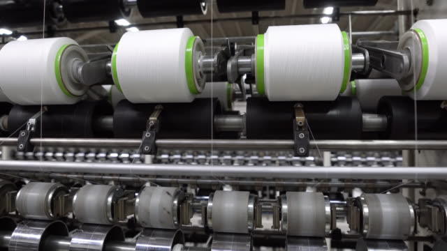 Close up of production line of plastic threads at a factory