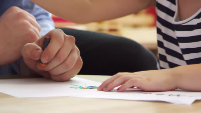 Close Up Of Pupil Drawing With Crayon In Montessori School Class video