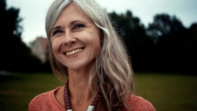 Close Up Of Radiant Mature Woman Standing In Park video