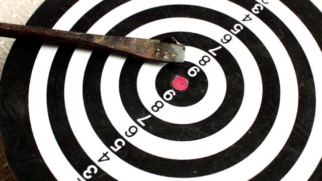 Close up of rotating dart board with broken arrow video