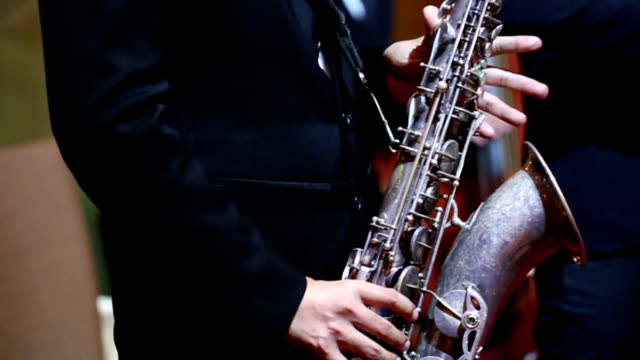 Close up of saxophone players : HD VDO video